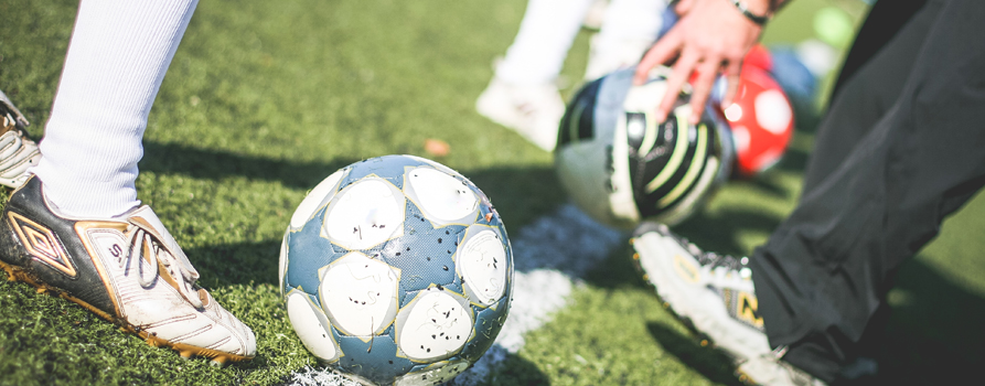 football-field-training-players-with-soccer-ball