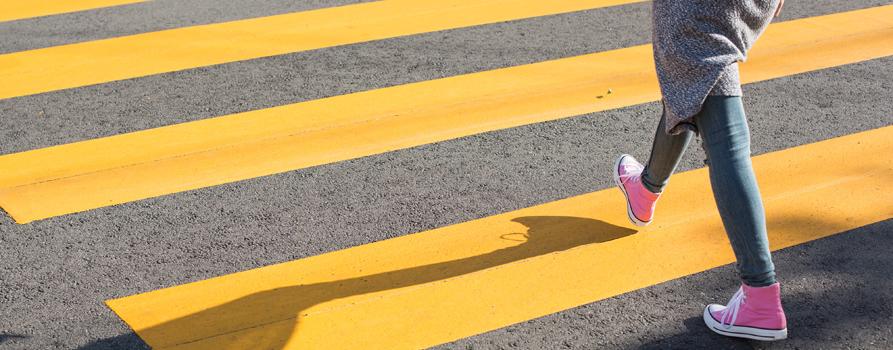 girl-crossing-street-on-a-yellow-crosswalk