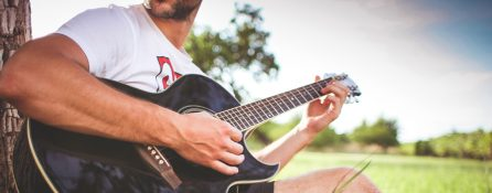 guy-playing-acoustic-guitar-in-nature
